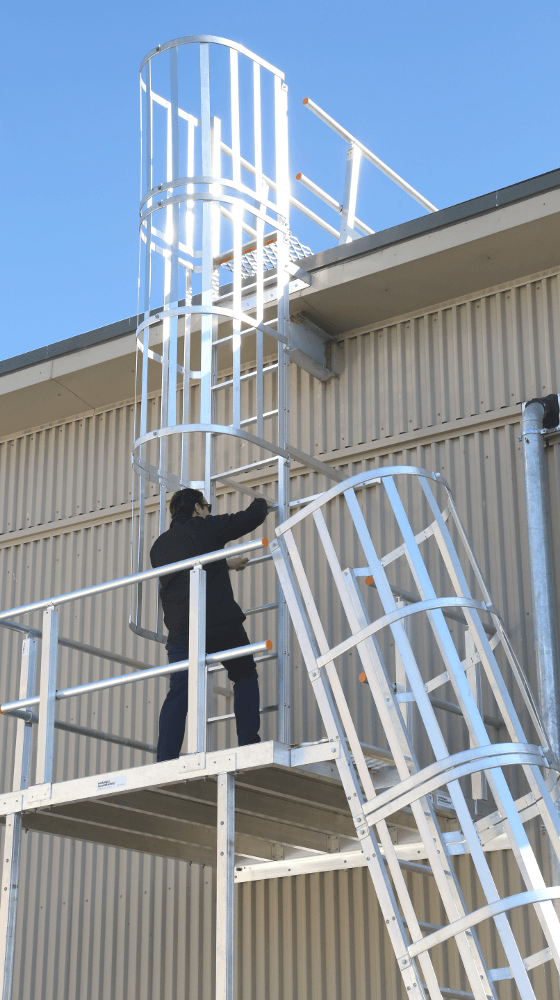 Climbing caged rung ladders