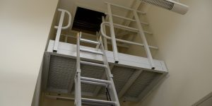roof access using ladder platform to access hatch