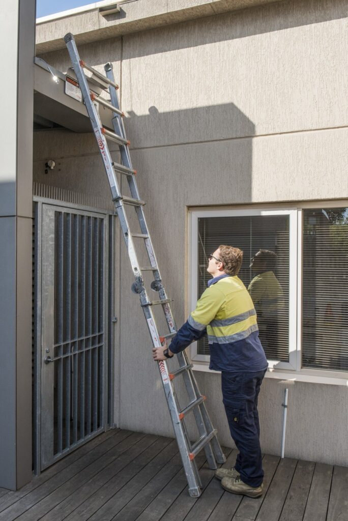 Roof access, ladder and ladder bracket