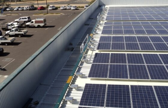 Roof walkway used to gain access to solar panels close to edge of building